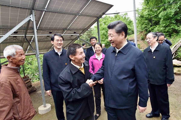 President Xi Jinping shakes hand with a villager at Dawan village in Jinzhai county, East China
