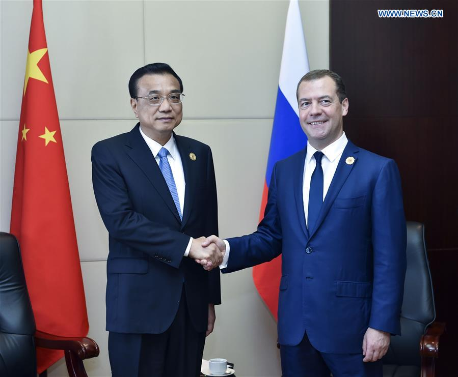 LAOS-CHINA-LI KEQIANG-RUSSIAN PM-MEETING