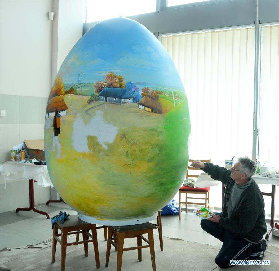 A local painter works on a large Easter egg in Koprivnica, Croatia, Feb. 28, 2017. Nearly 70 Easter eggs painted in Croatian Naive art style by the painters of Koprivnica have been displayed in many cities around the world during Easter in last 10 years.