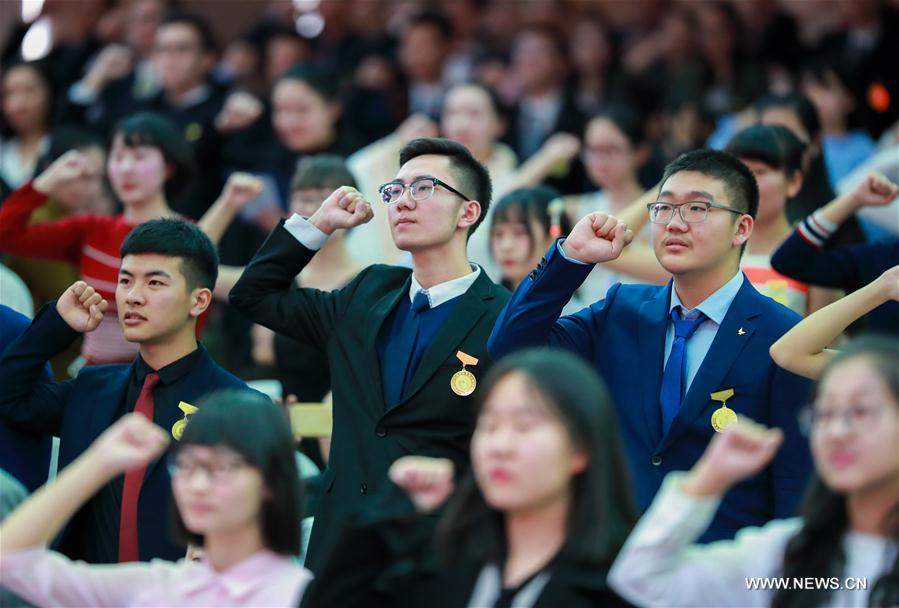 Students cheer at the adult ceremony for 18-year-old senior students in high school in Hohhot, capital of north China's Inner Mongolia Autonomous Region, March 7, 2017