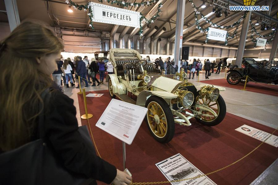 A visitor reads about information of a Mercedes Simplex 28/32PS on display at an old timer exposition in Moscow, Russia, on March 8, 2017.