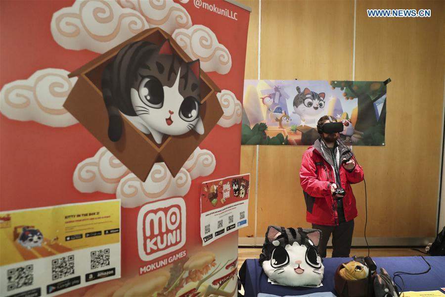 A visitor plays a cat-themed game during the Cat Camp in New York, the United States, on March 11, 2017.