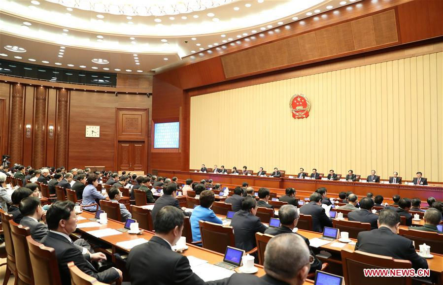 Zhang Dejiang, executive chairperson of the presidium for the fifth session of China's 12th National People's Congress (NPC) and chairman of the Standing Committee of the NPC, presides over the fourth meeting of the presidium for the fifth session of the 12th NPC at the Great Hall of the People in Beijing, capital of China, March 14, 2017.