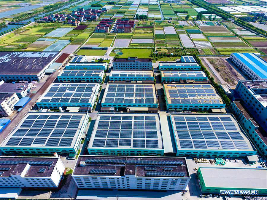 In pics: solar energy equipment on roof in E China