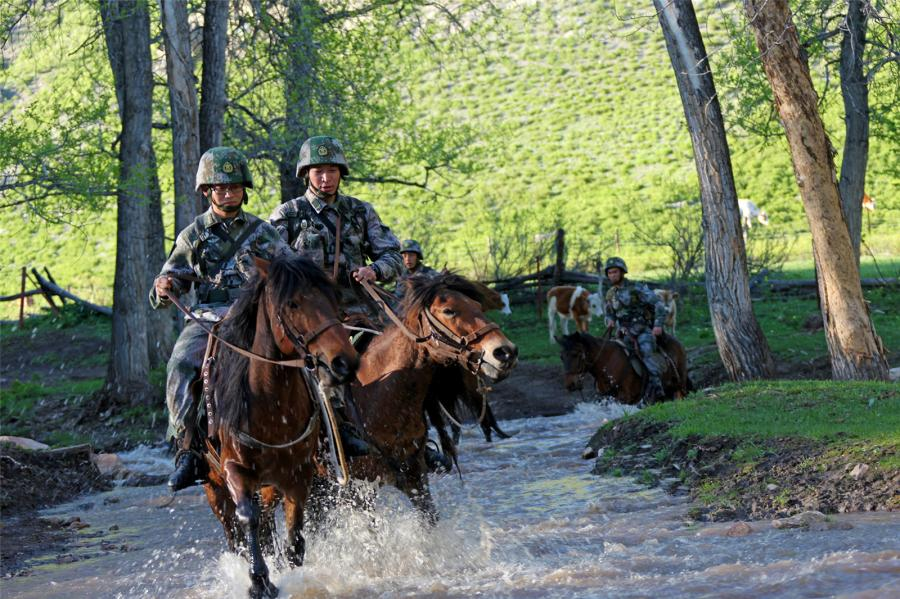 Soldiers patrol border areas on horseback