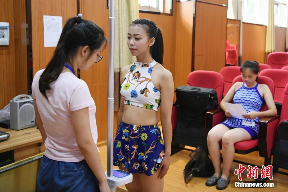 Students in swimsuit take test of flight attendance major in central China's Hunan Province
