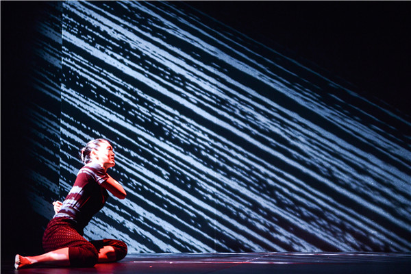 An actor performs on stage during a production of Titus Andronicus 2.0. [Photo: China Daily]