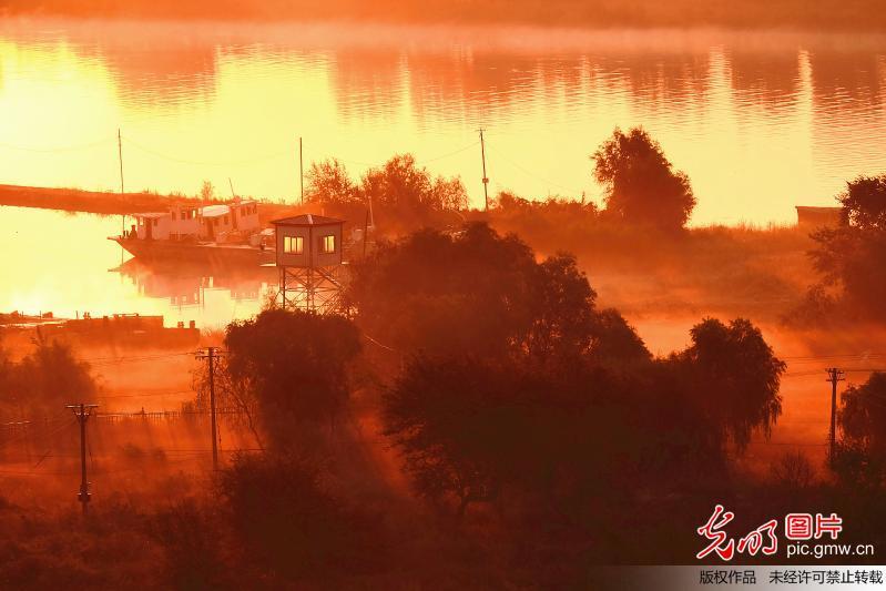 Beautiful sunrise scenery of Songhua River in Harbin
