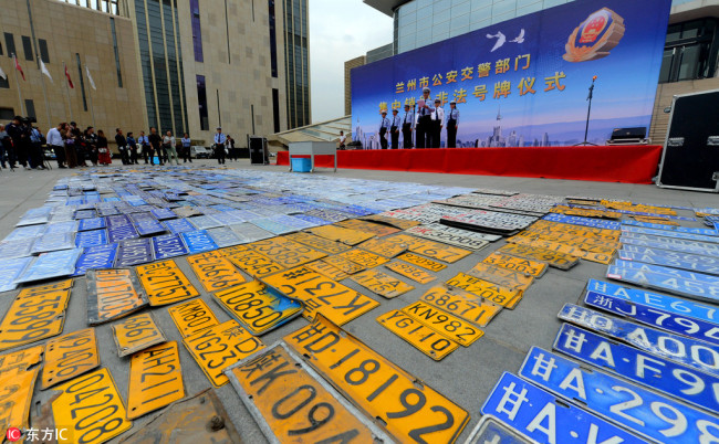 Local police in Lanzhou, the capital city of Gansu province, destroy around 836 illegal license plates on Wednesday. [Photo: China Plus]