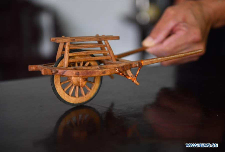 Pic story: carpenter makes wooden miniatures of farm tools