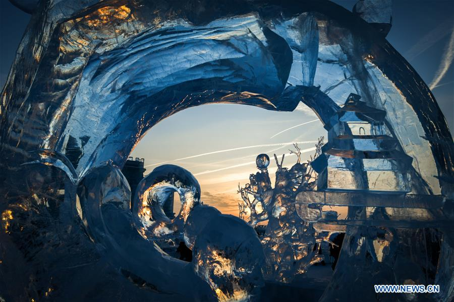 In pics: ice sculptures at sunset in Harbin