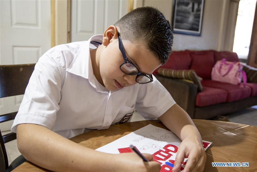 Costa Rican boy makes drawing to support China's coronavirus fight