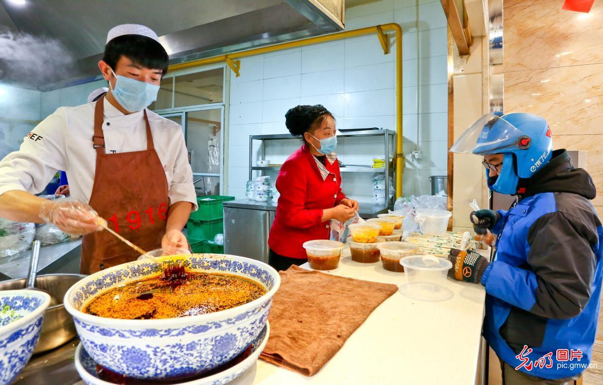 Restaurants gradually back in business under strict prevention measures in Zhangye, NW China's Gansu