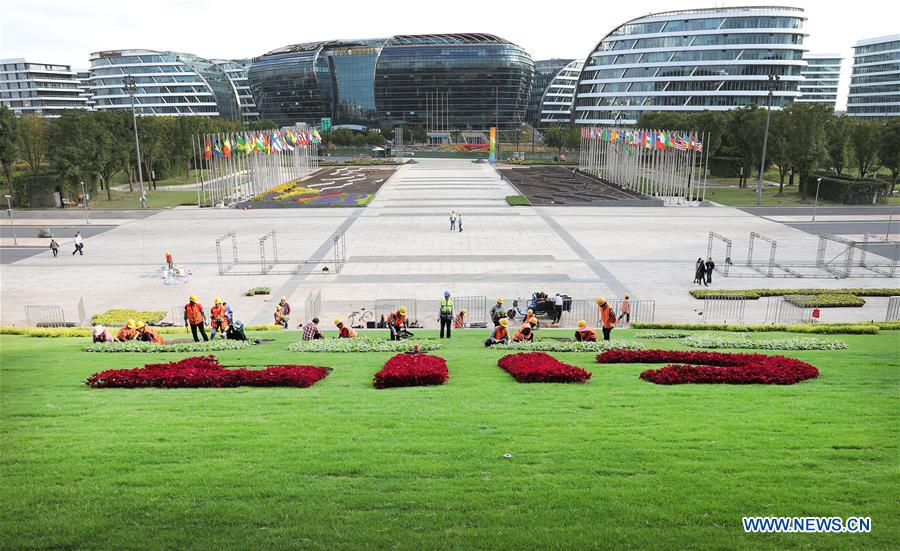 Gardeners prepare flower decorations for upcoming 3rd China Int'l Import Expo