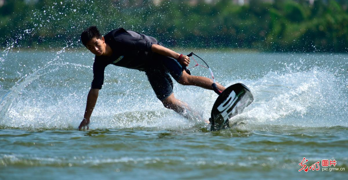 Tourists enjoy water skiing in Mile, SW China's Yunnan