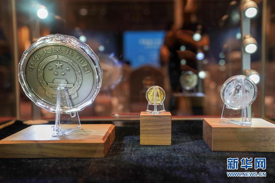 (图文互动)(2)世界遗产(良渚古城遗址)金银纪念币在良渚遗址首发